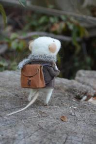 photo of white mouse withbackpack