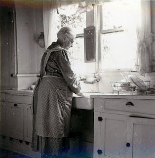 apron grandma at the sink